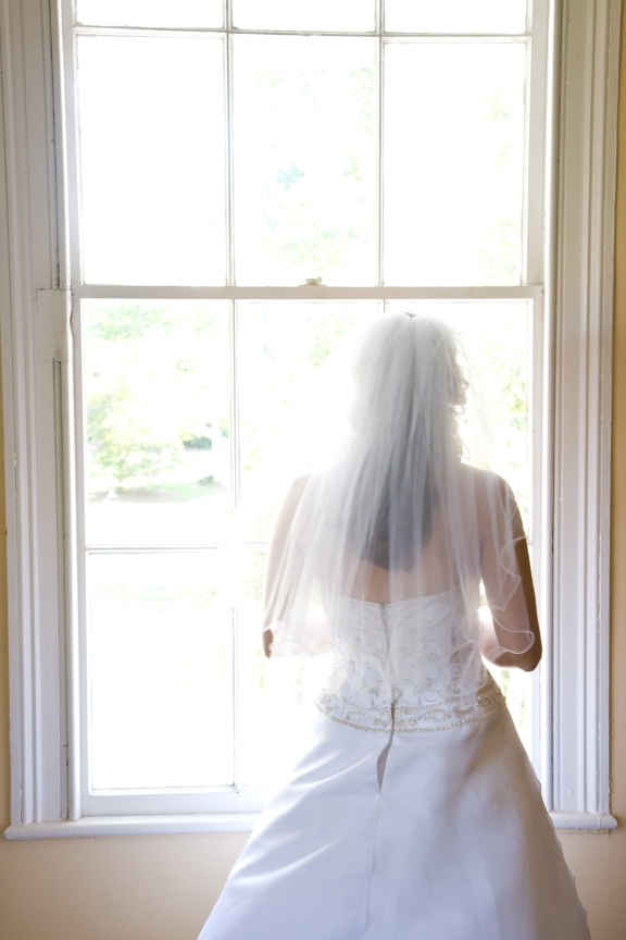 Bride in Window of Plantation House